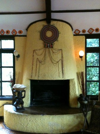 Sanctuary Olonana: Fireplace in the Lodge