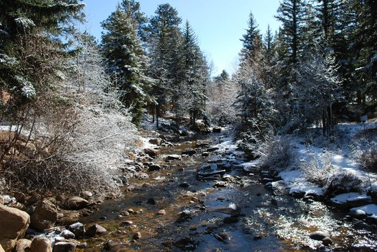 StoneBrook Resort: The Fall river behind the cabin, after a light snow.