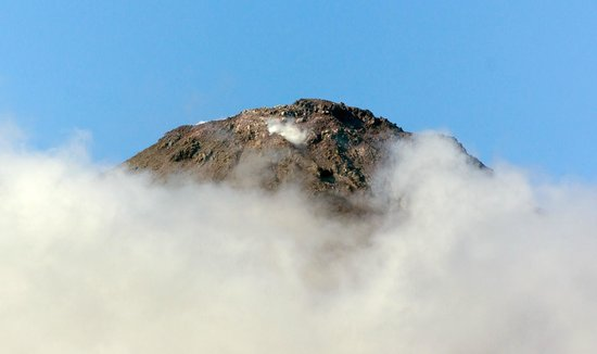 Arenal Manoa Hotel: The tip of the volcano as seen from our room (with a 300mm zoom lens)