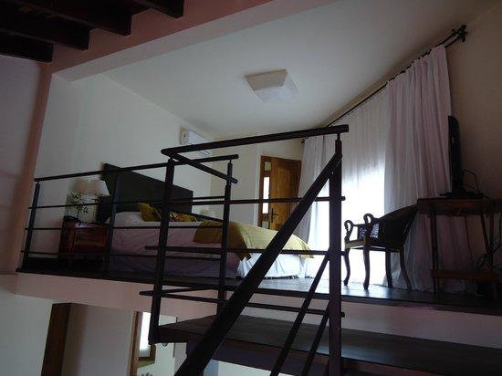 Kkala Boutique Hotel: Chambre à coucher à l'étage de la suite