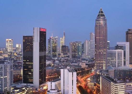 The Frankfurt Marriott Hotel located in the heart of a bustling city.