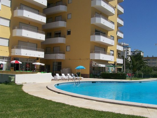 View of bars, pool and apartments - Picture of Solmonte Apartments ...