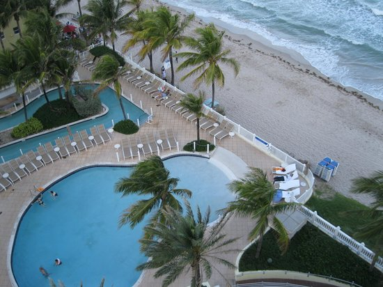 Pelican Grand Beach Resort, A Noble House Resort: view of pool, beach and lazy river