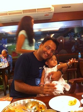 Saras, Pure Vegetarian Indian Restaurant: father daughter enjoying their meal