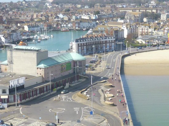 Roundhouse Hotel: View from Weymouth Tower. Hotel is in middle - between harbour & beach.