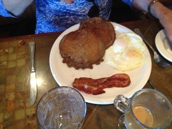 Chrissy's Cafe: blueberry hot cakes with bacon and two eggs fried