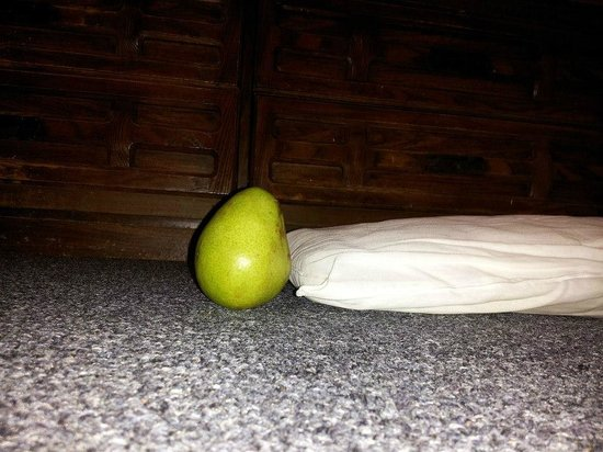 Friendship Hotel: this is how Thick the Pillows are (compared to a Small Pear) No, u cannot ask for an extra pillo