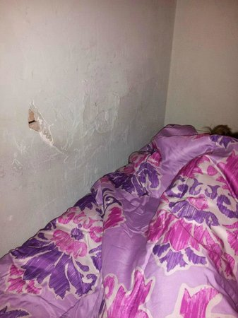 Friendship Hotel: sleeping next to hole in wall -spiders and bugs crawl in out of