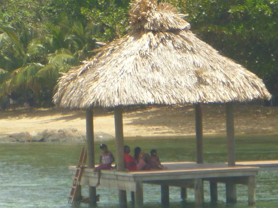 Blue Bahia Resort: local kids swimming off the next dock over