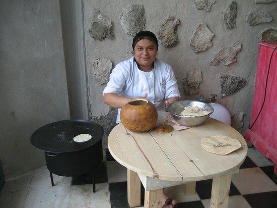 Hacienda Selva Maya: This lady is making fresh tortillas right in the main big room. Fun to watdch.