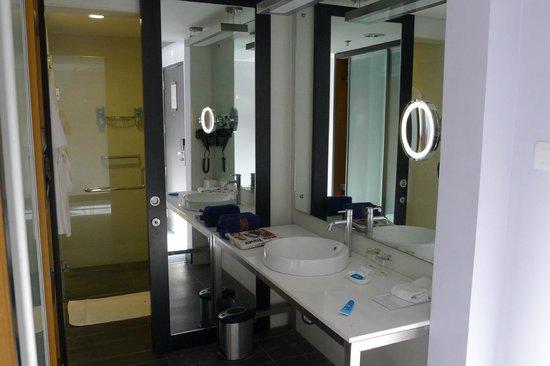 Medallion Chandigarh Zirakpur: Open washbasin area with closed toilet and bath area