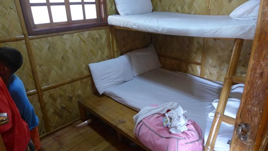 P&M Final Option Beach Resort: double-deck at one of the rooms, with small tv and an electric fan
