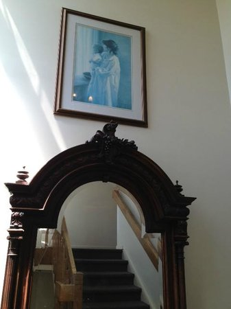 The Grenville: Hallway, I love this old mirror and photo of mother and child