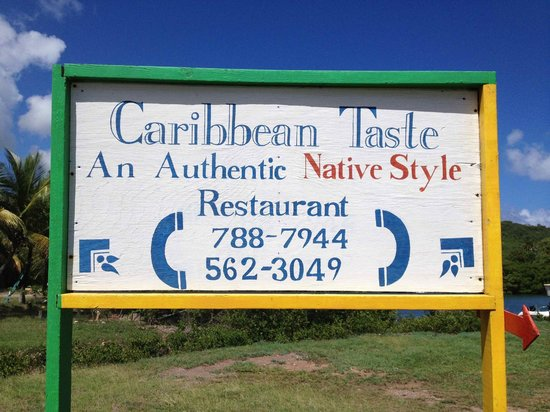 Caribbean Taste Restaurant : English Harbor: Main road sign -- The arrow points the way up the hill