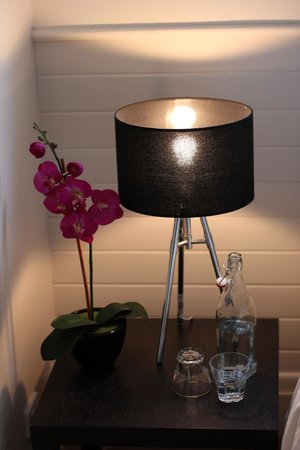 Tuck Inn Yarra Valley: Nightstand with a very welcome refreshment and nice floral touch