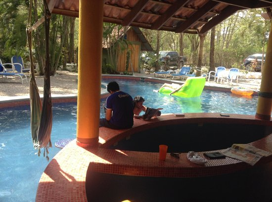 Hotel El Manglar: Look out over the pool... surf boards behind me.