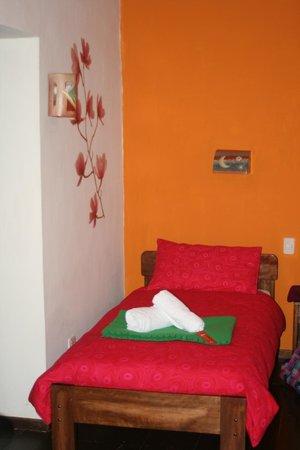 La Casa de Barro Lodge & Restaurant: chambre avec 3 lits