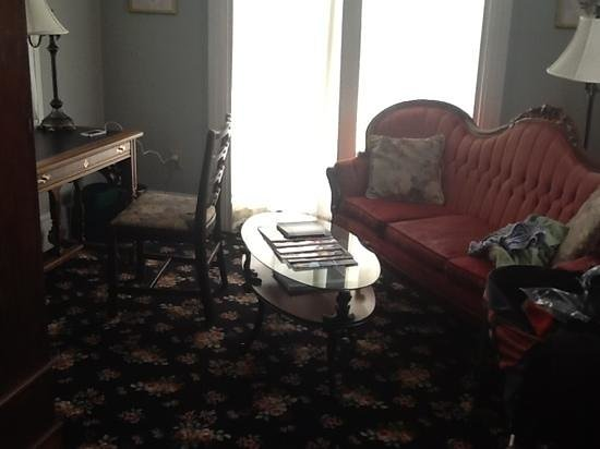 The Sayre Mansion Inn: sitting area next to bed