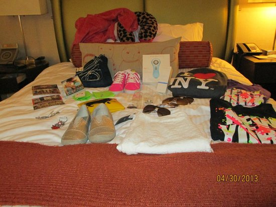 Shelburne NYC–an Affinia hotel: My nieces purchases on the comfy bed. Ultimately purchased a new suitecase to ship her items hom