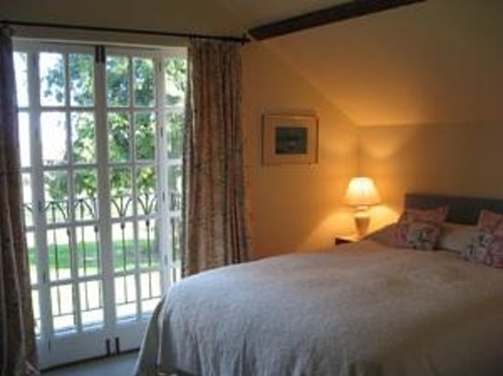 Staunton House: Master bedroom in barn conversion