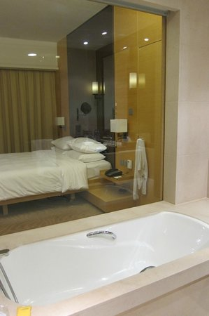 Hyatt Regency Hong Kong Sha Tin: view from bathroom to room unless you put the blinds down