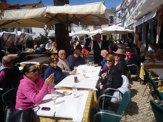 Palm Tree Pub Restaurante: Our group in the sunshine of the outdoor patio