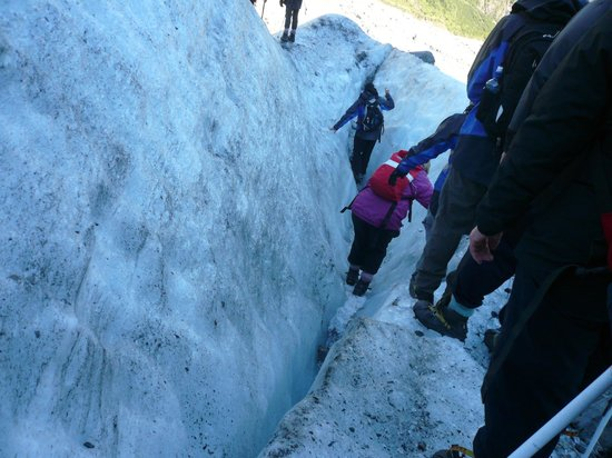 Fox Glacier, New Zealand: Dean with pic axe filling in for us to get through!