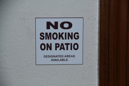Quality Inn & Suites: sign by patio door