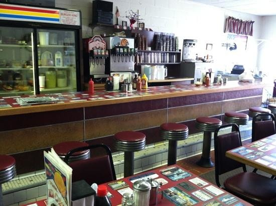 Ala Carte Cafe: Inside the Diner, notice the countertops with embedded local ads:)