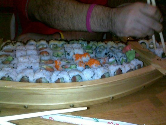 Sake Cafe: Sushi boat. Dont try this at home kids.