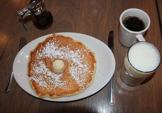 Colossal Cafe: Pancake, syrup, milk and coffee