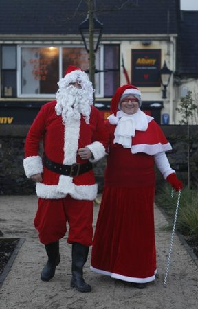 Ballina, Ireland: Santa Claus & Mrs Claus meeting and greeting the Children at the Jackie Clarke Collection, Dec 2