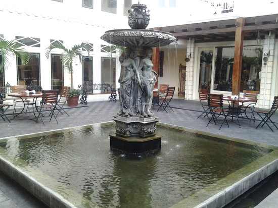 The Phoenix Hotel Yogyakarta - MGallery Collection: The Courtyard, a good place for ice cold beers after our day tour of Borobudur and Prambanan Tem