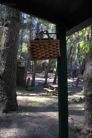 The Butterfly Garden Inn: The breakfast basket hanging outside the cabin door.