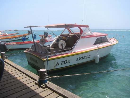 Boat tied to pier picture of zeerovers savaneta Fishing in aruba