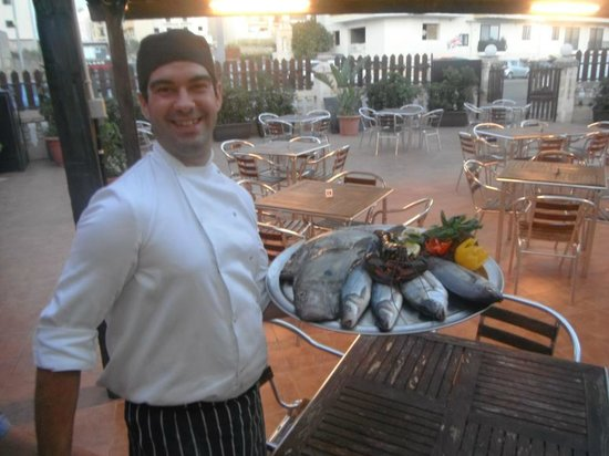 Re Leon : Our Chef Patron serving our customers with the fresh fish of the day.