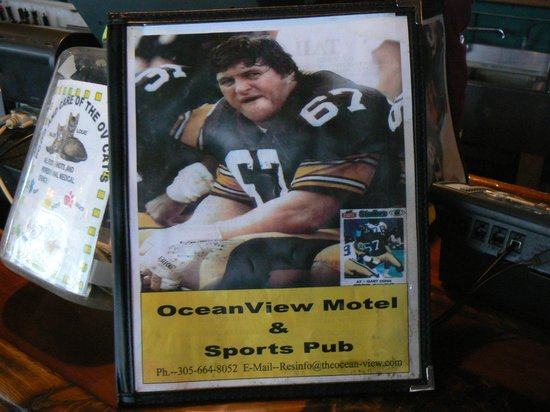 Ocean View Inn and Sports Pub: Menu with a photo of the owner in his Glory days.