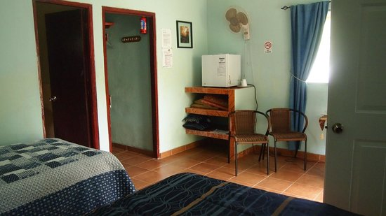 Cabanas Potosi: room showing closet, frige, shelf, fan, chair(2) and there is a small table