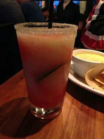 Fish Daddy's Grill House : Strawberry Margarita (with chips and queso in the background)