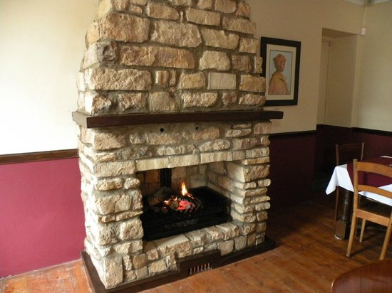 The Historic Pig & Whistle Inn: New fireplace built from recovered 1820 settler stone
