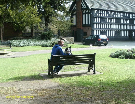 Bramall Hall: My husband and our darling dog enjoying the tranquility (yes she was leashed & her feet were dry