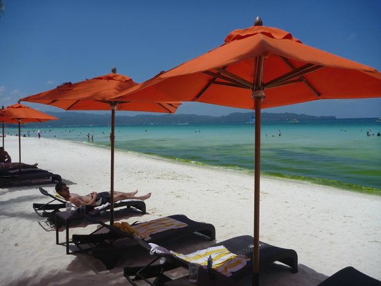 The District Boracay: The District's distinctive orange beach umbrellas