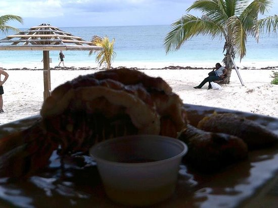Coral Reef Beach Bar: This was my fabulous lobster tail and the view from my table at Coral Beach bar and Grill!  Seek