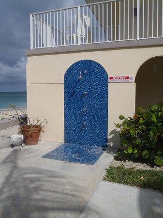 Cayman Reef Resort: The outdoor shower, there are two, keeps you from taking a lot of sand into the condo.
