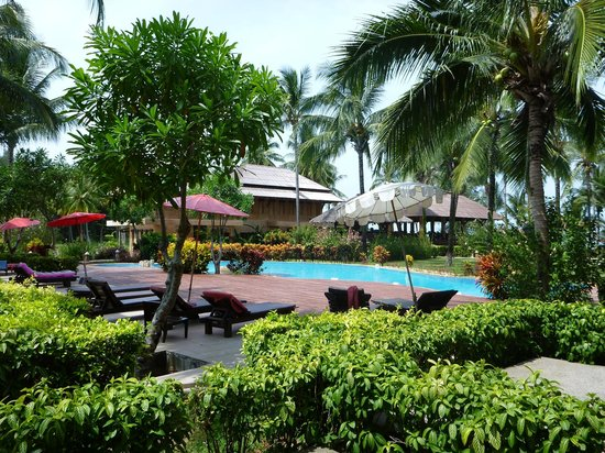 The Andamania Beach Resort: Patio view of pool and beach bar in the background