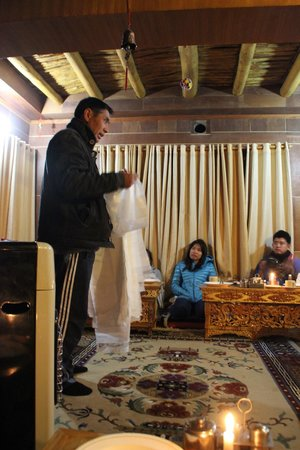 Silver Cloud Guest House: The host, Sonam, explains the white scarf give as appreciation and luck.