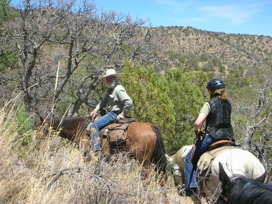 Hideout Ranch: Head Wrangler Craig leads guests up the trail to the wilderness above Portal...