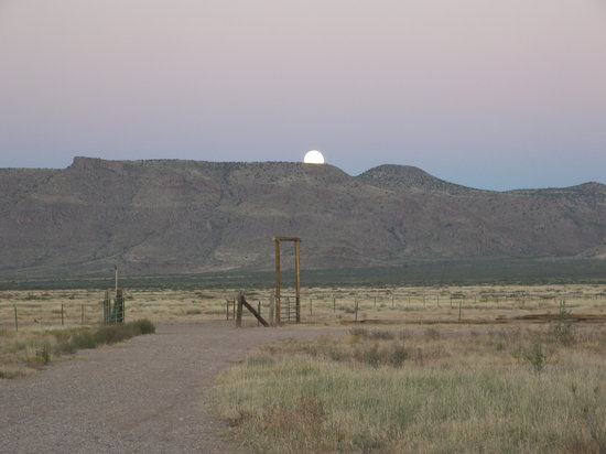 Hideout Ranch: The full moon floats above the Peloncillos as the soft purple pastels of twilight colour the des