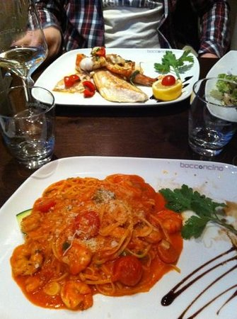 Bocconcino: Main course pasta (front) and incredible fresh fish platter (back)