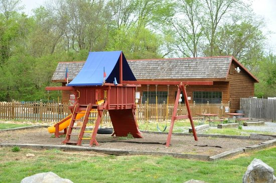 Whispering River Resort: Playground with pool in background
